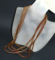 Serpentine Shimmer ... Long ndebele rope created with silver-lined beads in copper, topaz, bronze, and silver. Glitzy and gorgeous! :-) $ 130