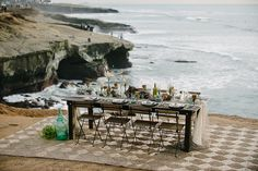 beach reception table - photo by John Schnack Photography http://ruffledblog.com/seaside-wedding-inspiration-shoot
