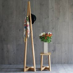 A stylish, modern, solid wood coat stand with adjustable stainless steel hooks. Handmade in Britain by Griffin+Sinclair.Available in natural oak, fumed oak (dark brown) or limed oak (lightly whitened oak).This handmade coat stand allows you move the pegs up and down the stand, which give you more hanging space, and allows children to reach the pegs too. It also means you can hang different items at different heights. Each one is made to order from sustainably sourced wood, with stainless…