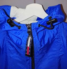 Tommy jeans vintage 90s, really rare item in great condition. 1/2 Zip. Thin Windbreaker. Drawstrings to adjust Hood and also at the bottom. Both work perfectly. Size M - perfekt for guys that has M, and its like a L-XL for the ladies. It looks good on everybody i would say. Have no idea