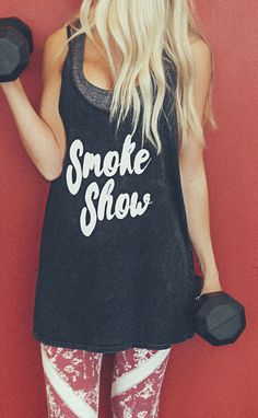 girl, you a smoke show... this bomb tank has a charcoal acid-wash look to it with an oversized fit and large armholes. wear it to the gym over a sports bra or r