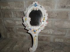 Very lovely, Italian hand painted floral art design wall hanging / hand held  vanity mirror is in Great - Good Condition, glaze crazing apparent,
