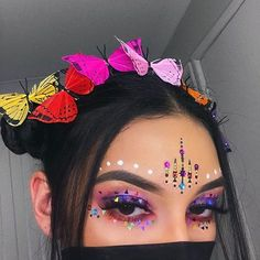 Another colourful festival look ---- BROWS #ABHbrows @anastasiabeverlyhills dipbrow in #darkbrown EYES @morphebrushes 35b palette // @jazzy_glitter on the lid/under eyes LASHES @lillylashes in Hollywood JEWELS @itsinyourdreams BUTTERFLIES @wildandfreejewelry
