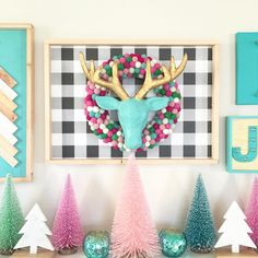 """Petite Party Studio on Instagram: """"Eeek! You know when you get an idea in your head and you're not too sure if it's gonna turn out? Well...I'd say this idea worked!!! Plywood, giftwrap, wood trim, felt ball wreath and a paper mâché stag head!! The perfect addition to my mantel decor!! #pps #petitepartystudio #ppsdiy #diy #holidays2015 #holidaydecor #hgtv #hgtvdesign #target #sharemytargetstyle #diydecor #feltballs #feltballwreath #manteldecor #holidaymantel #abmlifeiscolor"""""""