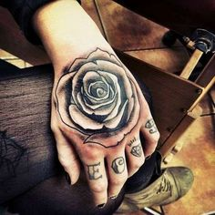 15 Black Rose Tattoo Meanings And Designs | InkDoneRight  A Black Rose Tattoo is a sign of many things. Hope, grief, rebellion, and death are just a few of its connotations. These black-and-white rose tattoo look..
