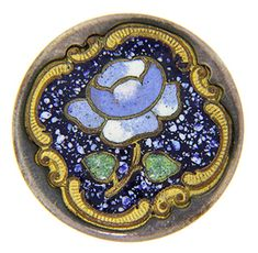 """A flower done in champlevé enamel decorates this brass antique button. The button measures 7/8"""" in diameter."""