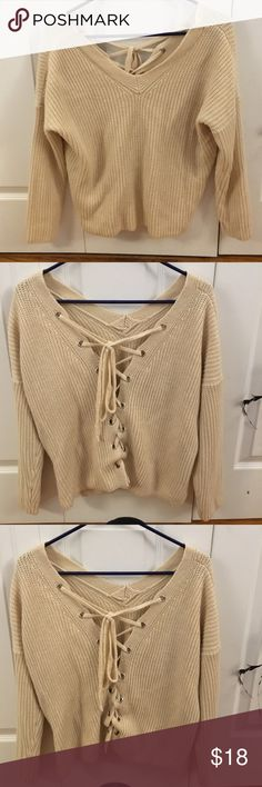 Cream V neck sweater Super cute lace up sweater! Great with jeans and boots! Sweaters V-Necks