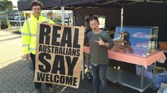 """Street artist Peter Drew is putting up 1000 posters bearing the statement """"Real Australians Say Welcome"""" as part of an art project-meets-political campaign on the subject of asylum seekers."""