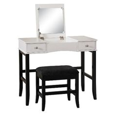 The Black and White Jackson Vanity Set is perfect for providing storage and grooming space in a large bathroom or bedroom. The spacious top features a flip top that has a hidden mirror and open storage area. Two storage drawers are accented with small round pulls and provide ample hidden storage space. The black and white contrasting finish and sleek design are ideal for any decor style.