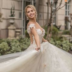 """Dripping in romance and exquisite details, Naama & Anat's """"Dancing Up the Aisle"""" bridal collection's got us twirling in delight. The draping"""