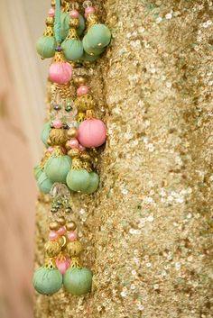 Bridal Details - Champagne Mint Sequins Lehenga with Pastel Green and Pastel Pink Pom poms | | WedMeGood #wedmegood #bridal #pompoms #latkan