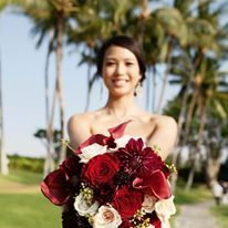 Exquisite Florals for your Destination Wedding in Hawaii. Dispersed white florals really soften down a classic red bouquet. Check out www.blissinbloom.com for more details about coordination for your destination wedding in Hawaii. www.blissinbloom.com Photographer: — #HawaiiWeddings #WeddingFlorals #WeddingBouquets #BrideBouquets #DestinationWedding #WeddingIdeas #BlissInBloom #Florals #Bride #Weddings #Bouquets #BeachWedding #RedWedding