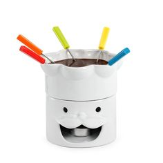 Ceramic Cartoon Happy Chef Design tea light burner and 6 metal fondue forks Suitable for meat cheese and chocolate fondues Comes with 6 Forks. Perfect summer table centrepiece for an outdoor BBQ party
