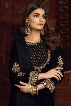 """As the melodious story continues, """"Gul"""" comes to life. It is a long, black velvet shirt with an elegant round neck and sleeves, intricately adorned with kora, dabka zari and aari. The fitted sleeves and long silhouette giving Gul a graceful look. It is paired with a pure black chiffon dupatta with hand embellished sequ Fancy Dress Design, Stylish Dress Designs, Ladies Dress Design, Pakistani Party Wear Dresses, Pakistani Dress Design, Velvet Pakistani Dress, Pakistani Suits, Velvet Dress Designs, Dress Neck Designs"""