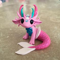 This little mer-dragon was inspired by my daughters bathroom. She