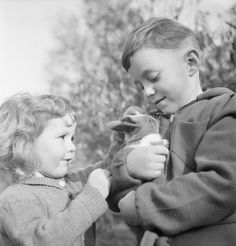 Two  refugees from Luxembourg with their pet rabbit in Surrey duirng 1942.