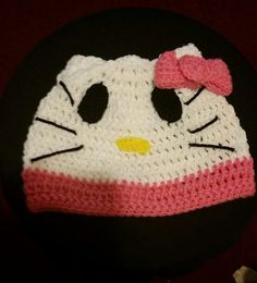 Teen / Small Adult Hello Kitty Inspired Beanie with Pink Trim and Bow  If you would like to order just www.etsy.com/shop/ALMBandJHANDMADE And pick one up today.