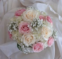 Sweet and soft bouquet affordable year around of hydrangea,spray roses,vandella and baby's breath. Pink and white weddings