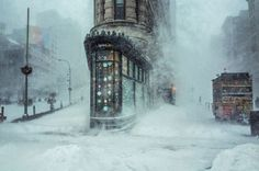 Flatiron Building captured by Michele Palazzo at New York City's record-breaking snowstorm in January 2016. The blizzard named 'Jonas' affected over 80 million people all along the east coast of the United States. With more than 26 inches of snow in less than 24 hours, Jonas was the second biggest blizzard in New York City's history