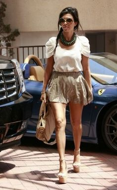 Kourtney Kardashian khaki shorts and turquoise necklate