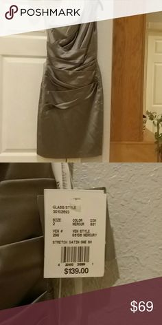 Stretch Satin Ruched Dress NWT. One Shoulder Beautiful Mercury Silver colored stretch dress. One shouldered size 2-6. Paid $139. So you're getting quite a bargain..very pretty. Very well constructed excellent fabric Dresses Midi