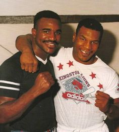 Evander Holyfield Mike Tyson | Evander Holyfield, Mike Tyson, a photo taken years before their two ...