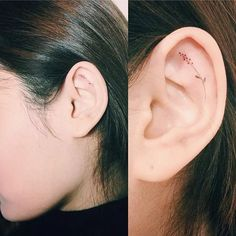 Ear tattoos are easy places that are difficult to nail. Some tattoo artists make the mistake of using lines that are too bold, making the microtattoo designs look too awkward for such a small area. Tattooist Doy does it right with a subtle, long-stemmed flower