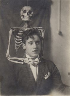 Print creepy vintage photos like this one in black and white and put in frames for seance room