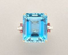 Gold, Aquamarine, Ruby and Diamond Ring   Centering one emerald-cut aquamarine, approximately 24.00 cts., flanked by 8 single-cut diamonds and 12 square-cut rubies, circa 1940, approximately 8.5 dwt