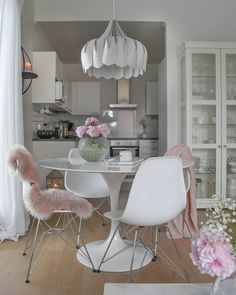 The unique flowing shape of the Peony lamp creates a focal point around the dining room table ✨ / Photo by Dining Room Table, Kitchen Dining, Dining Room Inspiration, Beautiful Lights, Ceiling Lamp, One Pic, Contemporary, Chair, Peony