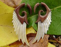 Fake Gauge Earrings ,Tribal Style, Mother of pearl, Shell, Angel wing, feather,Gold Shell,hand carved,organic. $24.99, via Etsy.