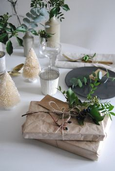brown paper Chrismtas wrapping idea with greenery Styling by Cate St Hill - 12 styled days of Christmas West Elm, Xmas Table Decorations, Festival Decorations, 12 Days Of Christmas, Christmas Crafts, Christmas Dining Table, Minimalist Christmas, Christmas Wrapping, Christmas Inspiration