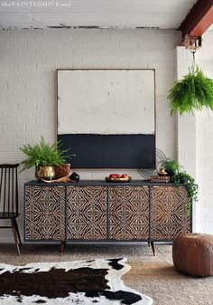 Boho furniture and decor - I love the credenza and cow-hide rug!