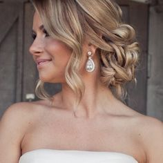 loose curls and romantic messy bun.