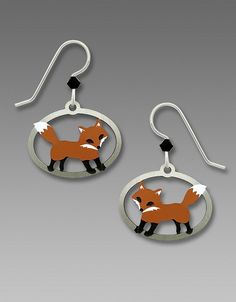Sienna Sky Fox in an Oval Frame Earrings on .925 sterling silver French hook ear wires. The earrings are made from etched nickel silver and hand painted in brown, white and black. The earrings measure