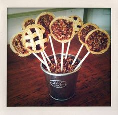 Pecan pie pops...edible centerpiece and favors. Just wrap the top of each pop with clear cellophane and tie a bow at the base for a take-home favor.