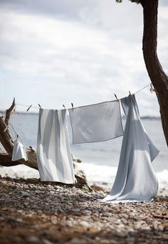 the sharp crack of sheets whipping in the stiff breeze - the sweet smell of sun-dried cotton