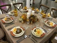 Columbus Bride: The Show Fall table: Antique farm chairs, burlap jute linen, poly copper napkins, glass bubble chargers, ivory rimmed china, brown prism plates, Ariana Amber wine glasses, Toscana water goblets, Pure champagne flutes, pebbled martini glasses, Farmington flatware.