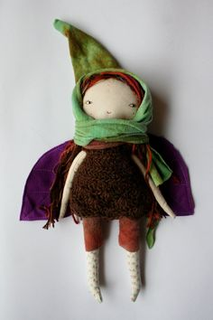 sweeeetie little pixie dolly. She has beautiful brown and earthy toned hair with streaks of bright pink. She is wearing a russet coloured hand dyed