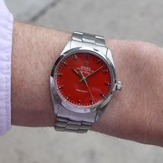 A 1966 vintage Rolex Air-King Ref. 5500. This stainless steel timepiece features a custom, refinished Red dial with applied steel bar markers, and a caliber 1520 automatic movement. At 34mm, this watch fits suitably on both men and women's wrists, and serves as a great piece to help break up the monotony of your daily watch wearing during this summer. (Store Inventory # 9954, listed at $3450). #rolex #airking #precision #red #dial #color #watch #watches #vintage #classic #wristwatch #ti