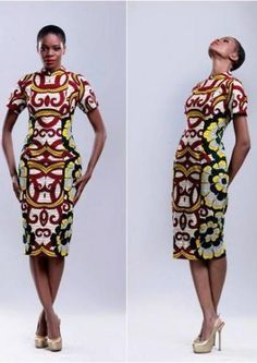I LOVE the shape. Sexy and sophisticated. Pret-tay! VG Bright bold African fitted dress