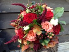 Rustic autumn wedding bouquet deep red, cherry brandy roses, hypericum,Amaranthus www.thefloralartstudii.co.uk