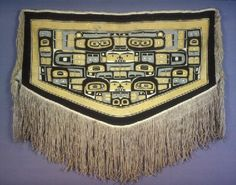 """blanket, mountain goat wool, yellow cedar bark.    Dancing blanket of the northern northwest coast, named the """"Chilkat blanket,"""" after the Tlingit tribe whose weavers specialized in its making in the nineteenth century."""