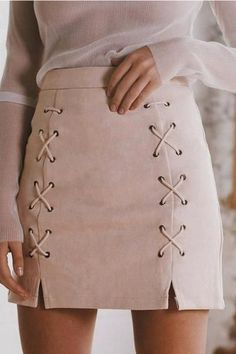 Try a blush-colored lace-up skirt this fall for a fun twist to your usual look. Let Daily Dress Me help you find the perfect outfit for whatever the weather! dailydressme.com/
