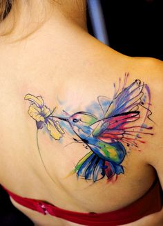 Colorful Humming bird tattoo. For more stunning and wonderful tattoo ideas and design, visit www.tattooenigma.com