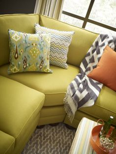 Mixing Patterns. Love the zigzag and ikat pillows--> http://www.hgtv.com/designers-portfolio/room/eclectic/living-rooms/8658/index.html#/id-8050/room-living-rooms?soc=pinterest