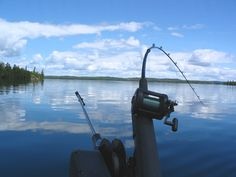 """A perfect June day on Crow Lake in Nestor Falls, ON. - Downrigging for Lake Trout Photo submitted by Tom Klabechek for the NOSFC's """"Best Fishing Photo"""" Contest."""