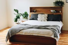Platform bed with Bookshelf bedhead - Featuring the popular bookshelves but elevated on top of a platform base. Custom made from locally sourced, recycled hardwood timbers. A unique forever bed handmade on the Surf Coast of Victoria, Australia. Timber Furniture, Custom Furniture, Bedroom Furniture, Home Furniture, Bedroom Decor, Timber Bed Frames, Timber Beds, Timber Bedhead, Bookshelf Bed