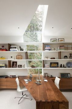Love this super incredible workspace! Beautiful shelves and built-in cabinets, a desk with tongue in groove joinery all white super contemporary. Love skylight bringing the outdoors in. Modern feel and touch everywhere.