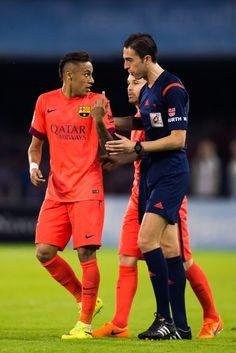 Neymar Santos Jr of FC Barcelona argues with referee Inaki Vicandi Garrido during the La Liga match between Celta Vigo and FC Barcelona at Estadio Balaidos on April 5, 2015 in Vigo, Spain.